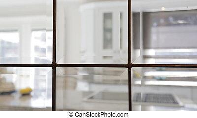 Modern Kitchen interior. Shot through window