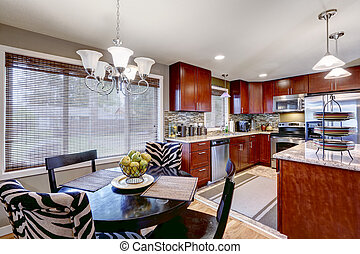 Modern kitchen interior with dining area