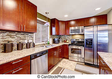 Modern kitchen interior with mosaic back splash trim and granite