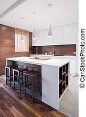 Modern kitchen island - White and modern kitchen island in...