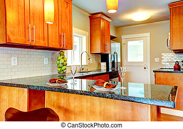 Modern kitchen room interio with decorated granite counter...