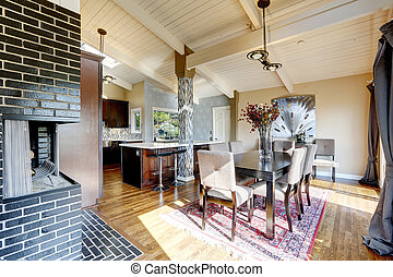 Modern kitchen room interior with fireplace and dining area
