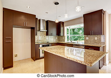Modern kitchen room with matte brown cabinets, shiny granite tops, steel stove with hood, granite back splash trim and marble tile floor