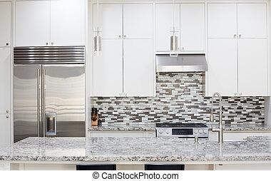 Snapshot of interior modern kitchen with granite countertop island and smart refrigerator