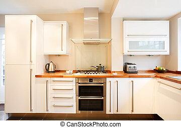 Modern kitchen - Modern white kitchen with wooden worktops...