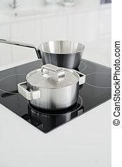 Modern kitchen - stove of a modern kitchen. short depth of...