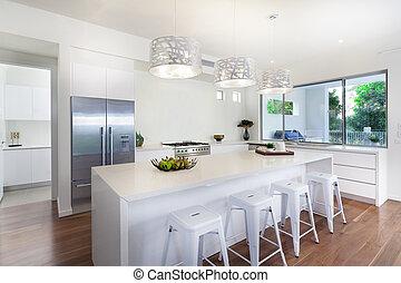 Modern kitchen - Stylish open plan kitchen overlooking the ...