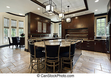 Modern kitchen with large island and circular eating area