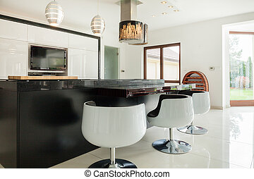 Modern kitchen with dining area - View of modern kitchen...