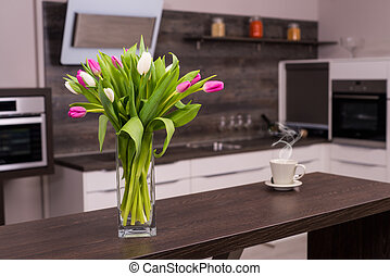 Modern kitchen with flowers and coffee.