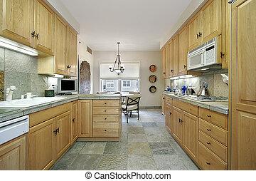 Modern kitchen with slate floor