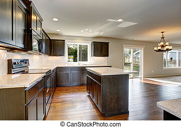 Modern kitchen with stained cabinets.