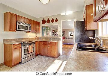 Modern kitchen with tile floor.