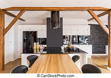 Modern kitchen with white cabinets and black designed...