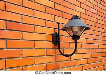 Modern lamp on a brick wall