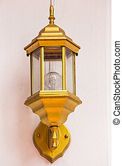 Modern lamp on wall with wallpaper background.