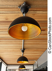 Modern lamp on wooden ceiling