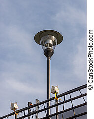 Modern lantern pole with the small lamp.