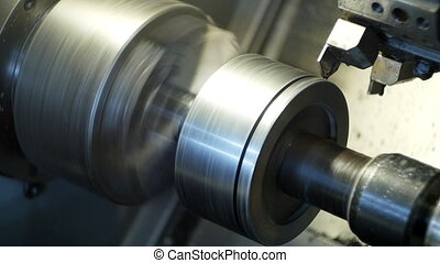 Modern lathe CNC grinds metal part for mechanical...