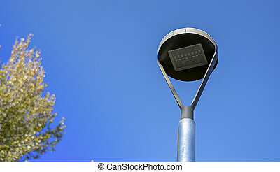 Modern LED street lamp with blue background