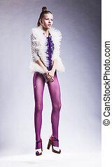 Modern lifestyle - fashion woman model posing in pink stockings