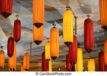 A modern lamp made out of multiple colured plastic diffusers.