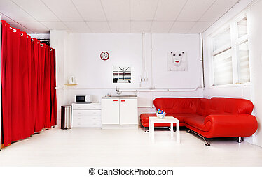 Modern minimalist living room interior with a large red sofa and matching curtain and white cabinetry