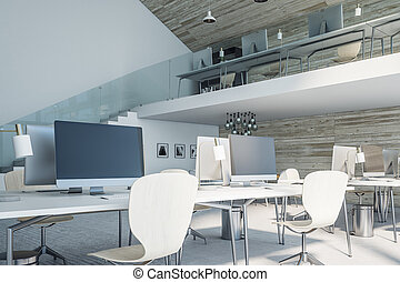 Modern loft office space with computers