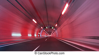 modern long highway tunnel in a red light