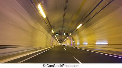 modern long highway tunnel in a yellow light