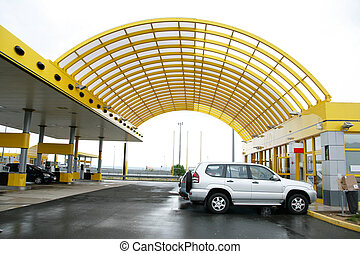 Modern looking petrol gas station on side of highway