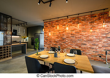 Modern luxurious dark gray and kitchen with dining table