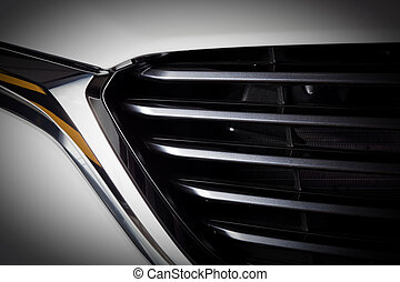 Modern luxury car close-up of grille. Expensive, sports auto...