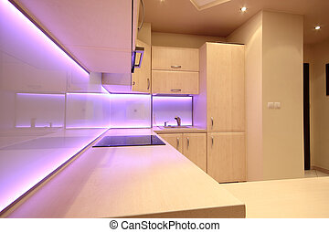Modern luxury kitchen with pink LED lighting