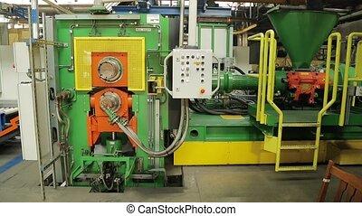Modern machine at tire factory prepare rubber tape - Modern...