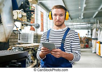Modern Machine Operator Working at Plant