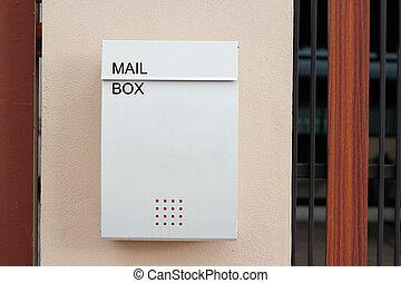 Modern mailbox on a wall fence