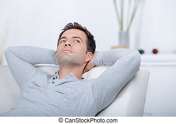modern man sitting relaxed on a sofa