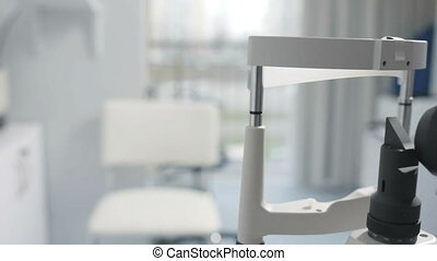 Modern medical device with slit lamp for eye checking -...