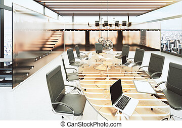 Modern meeting room in bright office with a glass table and black chairs