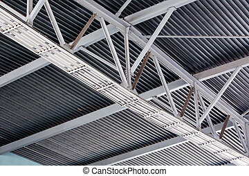 Modern metal roof inside storehouse - Ceiling fragment of...
