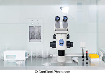 Modern microscope in biotech lab. Equipment in laboratory of Fertilization.