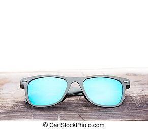 Modern mirror sunglasses on a wooden table