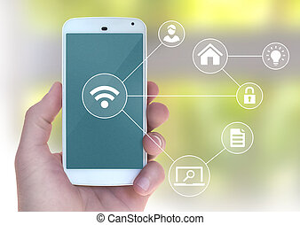 Modern mobile smart phone connecting to wifi automation apps in male hand