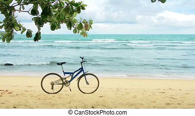 Modern mountain bike on the beach without people. Thailand. Phuket