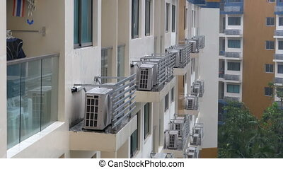 Modern Multi-storey building with many air conditioners in...