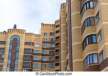 modern multi-storey residential building brick