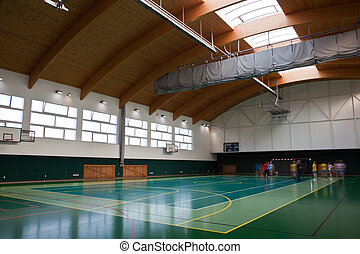 modern multifunctional gymnasium with young people getting ready for training