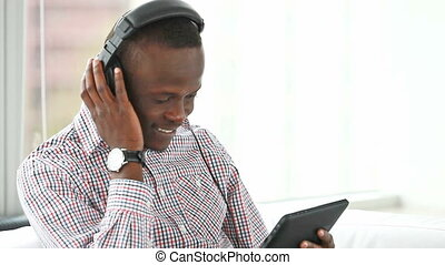 Modern music - Cool guy with touchpad listening to the music...