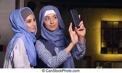 Modern Muslim Women Talking and Smiling
